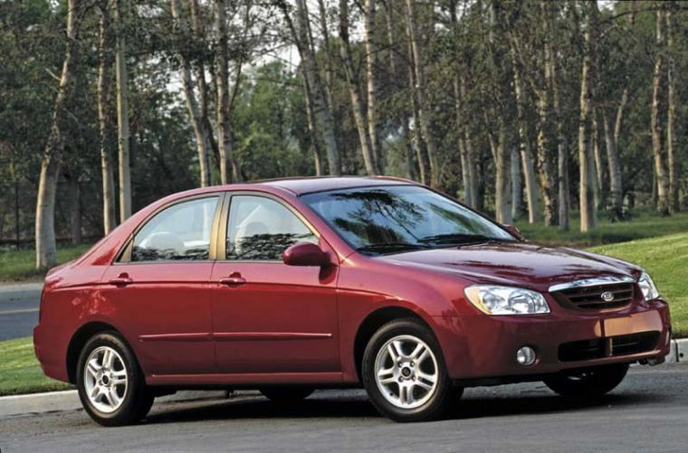 2004 maroon kia spectra front right car photo kia car pics. Black Bedroom Furniture Sets. Home Design Ideas