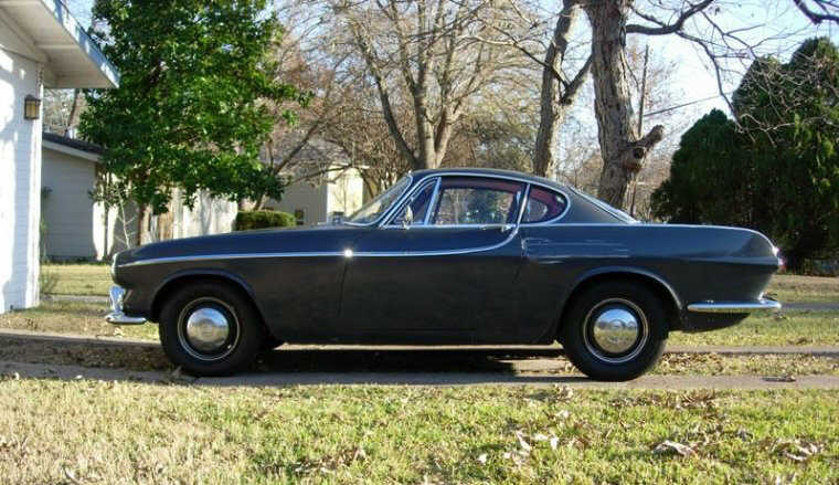 Presents a left side black 1964 Volvo 1800S Car Picture